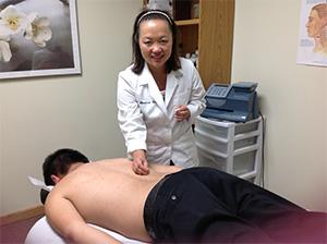 Patient receiving acupuncture treatment.