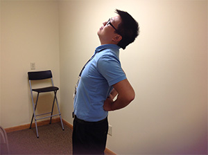 Hmong man experiencing back pain