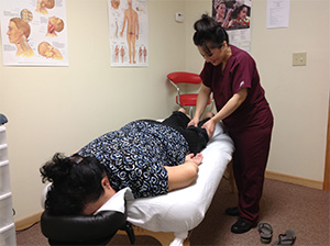 Hmong patient receiving theraputic massage